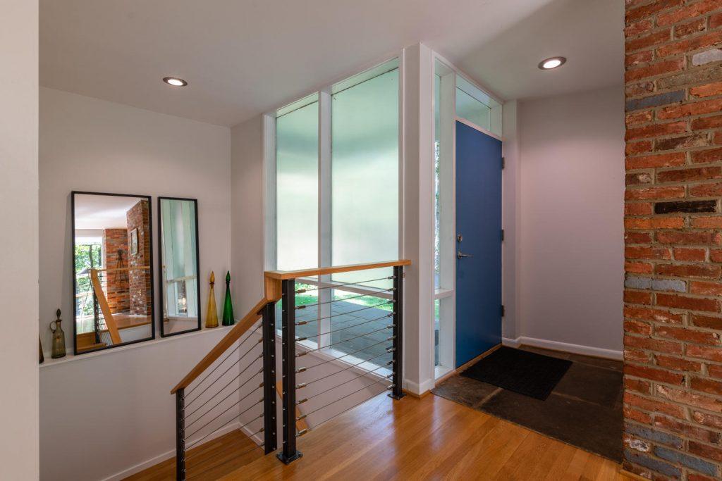 Modernist railing in Charles Goodman-designed mid-century modern home in Potomac, Maryland.