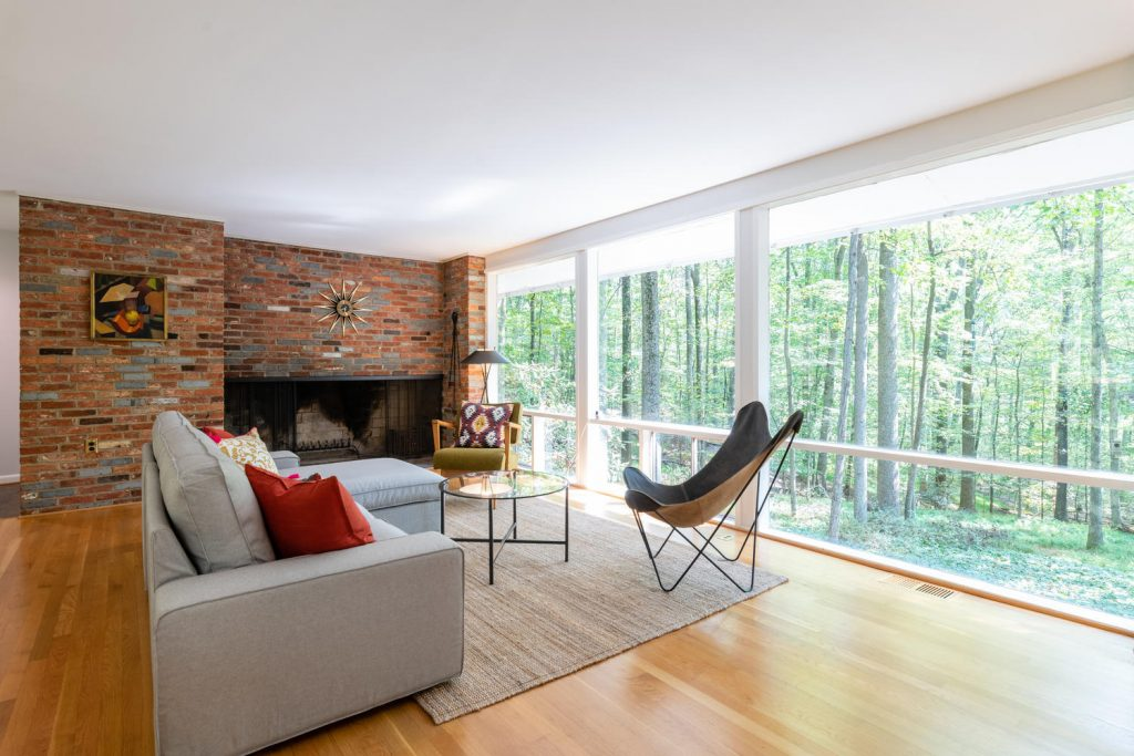 Expansive end-wall fireplace in Charles Goodman-designed mid-century modern home in Potomac, Maryland.