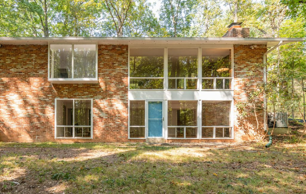 The mid-century modern home in Potomac, Maryland back to Watts Branch park.