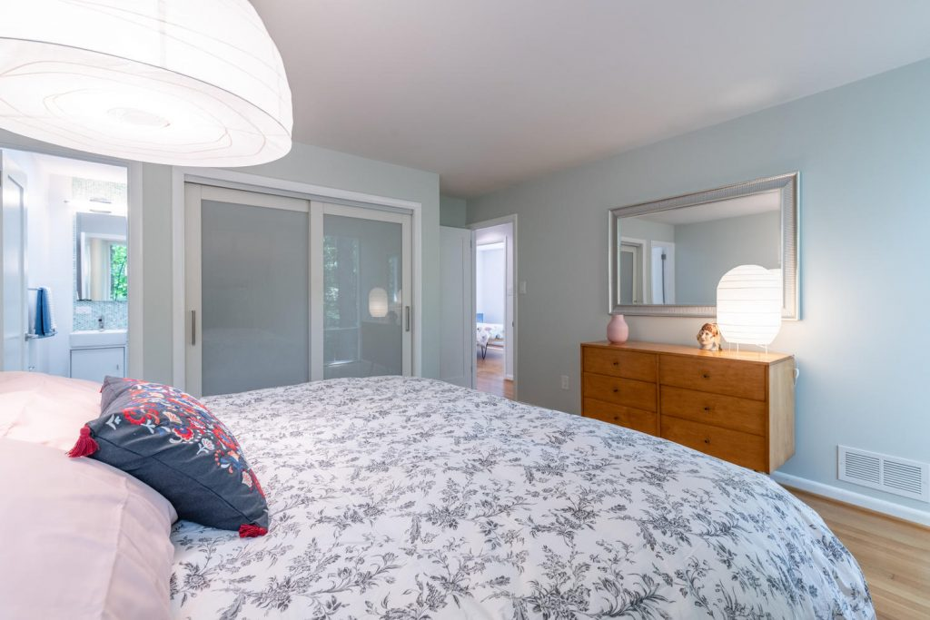 Master bedroom in a Charles Goodman-designed mid-century modern home in Potomac, Maryland.