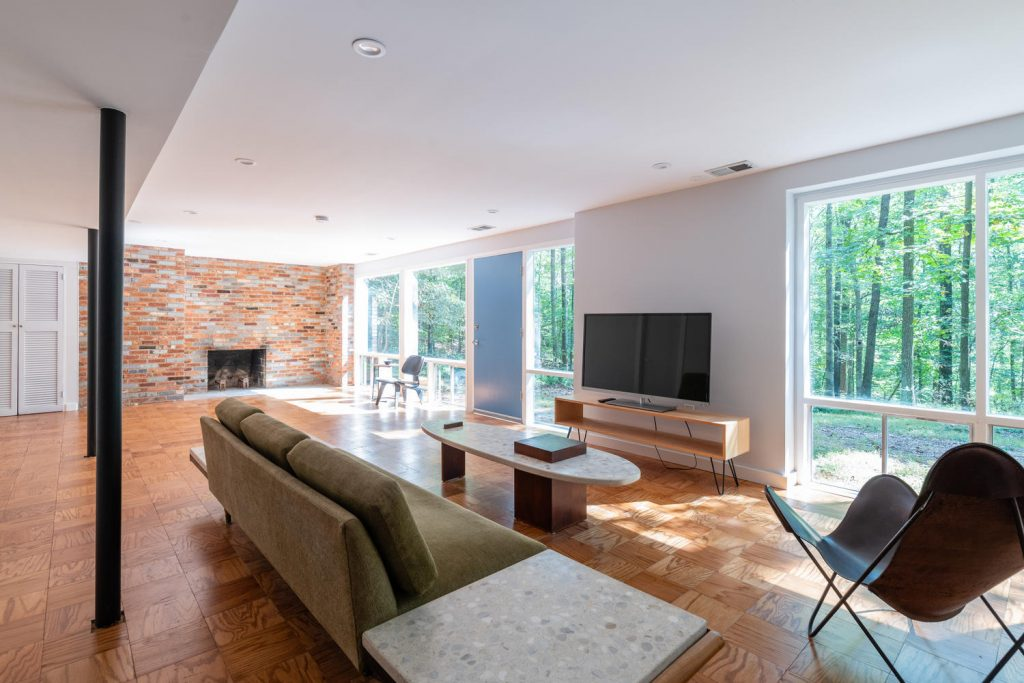 Expansive lower level of a Charles Goodman-designed mid-century modern home in Potomac, Maryland.